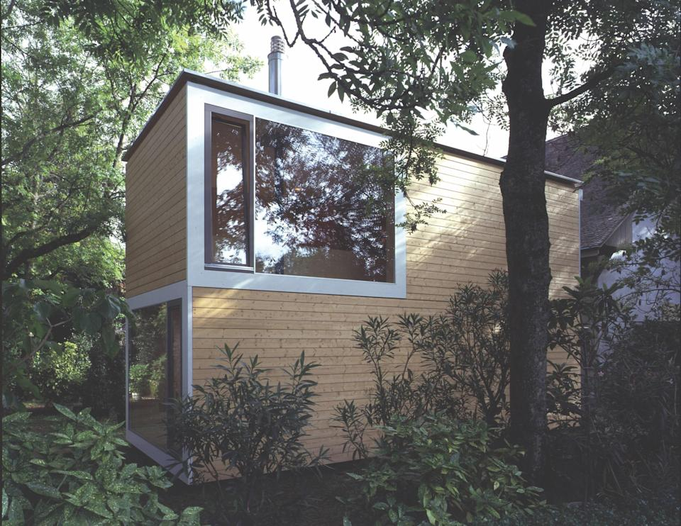 Bauart Architekten's two-story wood-framed Smallhouse can be assembled in one day on-site and features four panoramic windows—one for each zone in the home. The compact design's layout can be customized to include an interior atrium, and future additions can easily be incorporated.