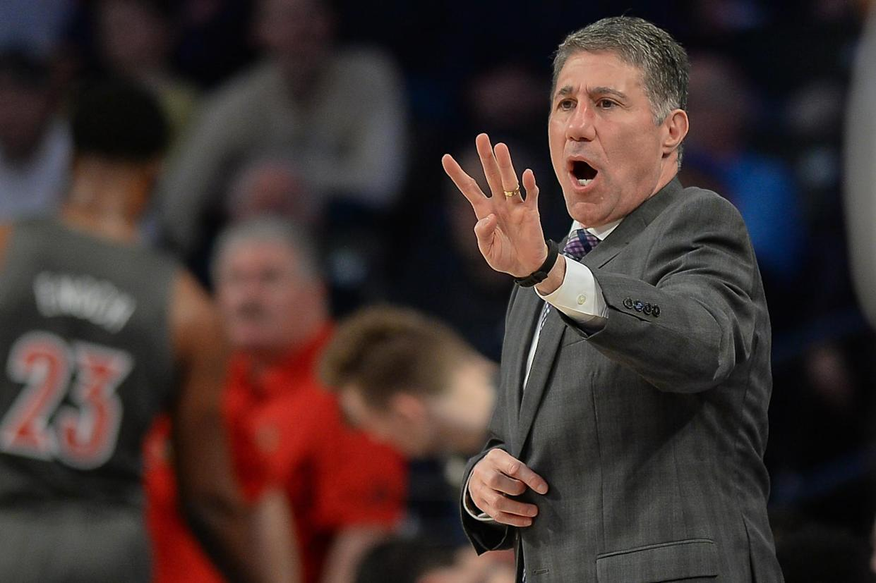 ATLANTA, GA  FEBRUARY 12:  Louisville assistant coach Dino Gaudio gestures from the sideline during the NCAA basketball game between the Louisville Cardinals and the Georgia Tech Yellow Jackets on February 12th, 2020 at Hank McCamish Pavilion in Atlanta, GA.  (Photo by Rich von Biberstein/Icon Sportswire via Getty Images)