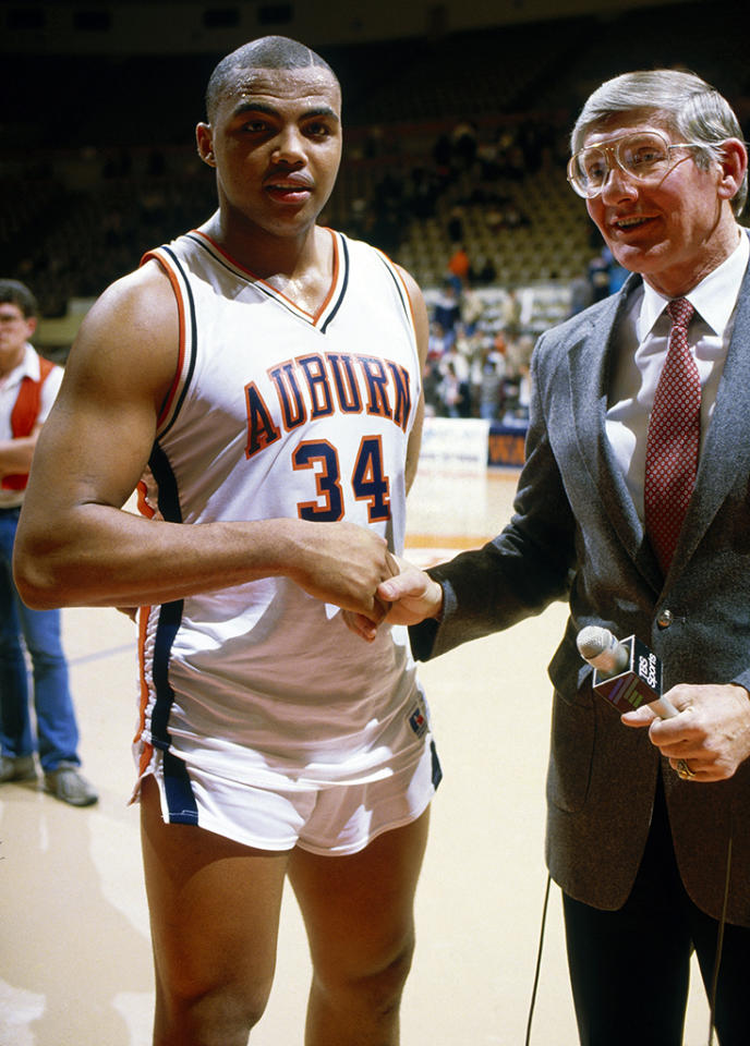 University of Auburn's center Charles Barkley #34 shakes hands with a reporter following a circa 1982 game.