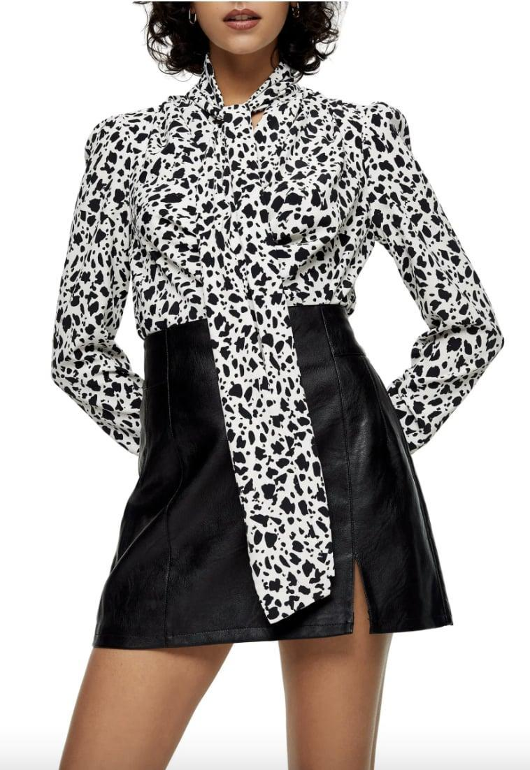 <p>This <span>Topshop Animal Print Tie Neck Blouse</span> ($39, originally $58) will stand out in your next Zoom meeting. </p>