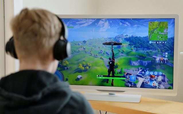 Teenager playing the online game Fortnite - Alamy Pay