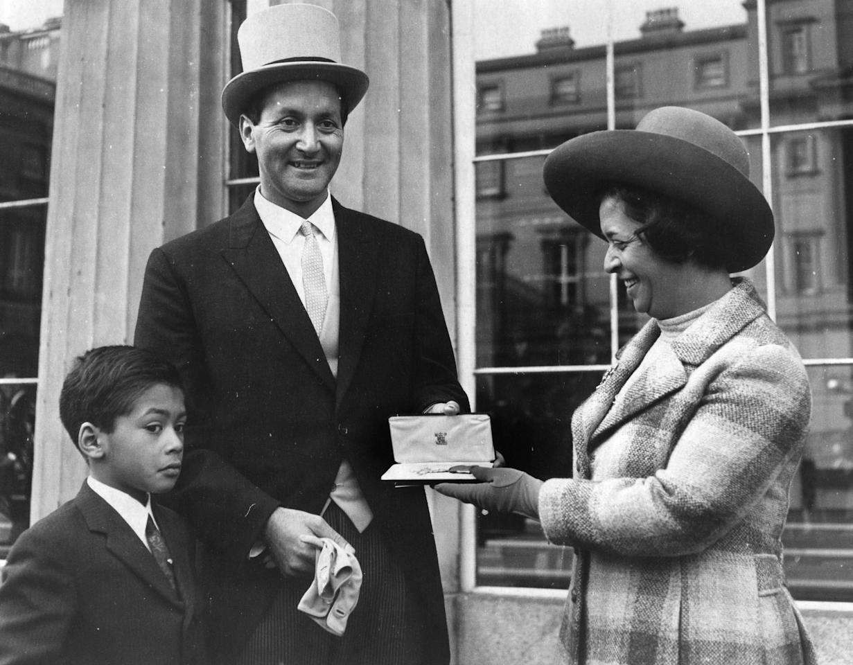 Basil Lewis D'Oliveira, the South African born cricketer, with his wife and son, Damien at Buckingham Palace where he has just been presented with an OBE by the Queen. He has played for Lancashire, Worcestershire and England.    (Photo by Central Press/Getty Images)