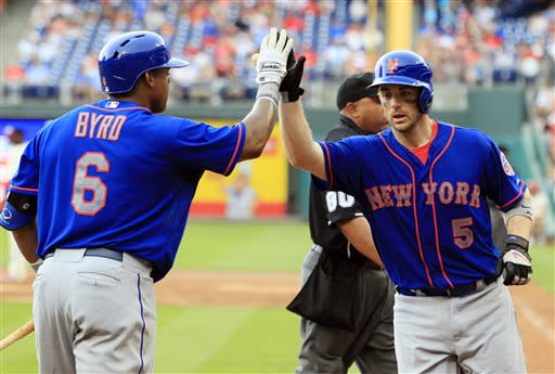New York Mets' Marlon Byrd, left, congratulates teammate David Wright on his solo home run during the ninth inning of a baseball game with the Philadelphia Phillies, Sunday, June 23, 2013, in Philadelphia. The Mets won 8-0. (AP Photo/Tom Mihalek)