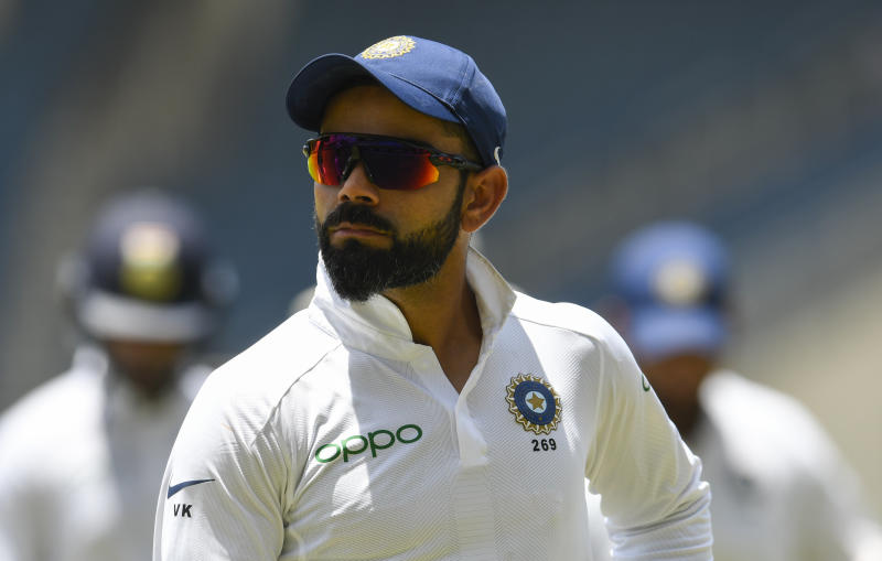 Virat Kohli of India walks off the field at the lunch break during day 4 of the 2nd Test between West Indies and India at Sabina Park, Kingston, Jamaica, on September 2, 2019. (Photo by Randy Brooks / AFP) (Photo credit should read RANDY BROOKS/AFP/Getty Images)