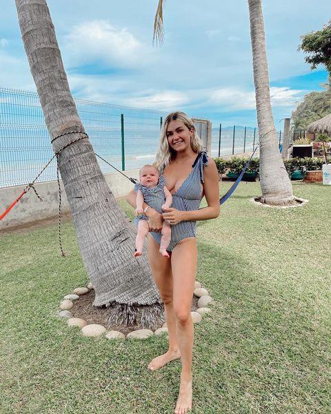 """<p>Lindsay Arnold <a href=""""https://people.com/parents/lindsay-arnold-twinning-newborn-daughter-matching-swimsuits/"""" rel=""""nofollow noopener"""" target=""""_blank"""" data-ylk=""""slk:got verklempt over her ability to twin"""" class=""""link rapid-noclick-resp"""">got verklempt over her ability to twin</a> with her daughter, Sage. She captioned a series of photos of the pair in striped suits, """"Emotional over these pics 😭😭 Matching swimsuits with MY daughter? 😭 can't believe I get to be this sweet girls mama forever ❤️."""" </p>"""