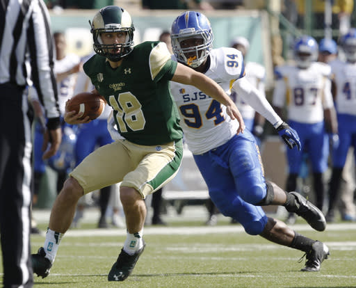 Colorado State quarterback Garrett Grayson, left, looks to run while pursued by San Jose State defensive tackle Eugene Taylor in the first quarter of an NCAA college football game in Fort Collins, Colo., on Saturday, Oct. 12, 2013. (AP Photo/David Zalubowski)