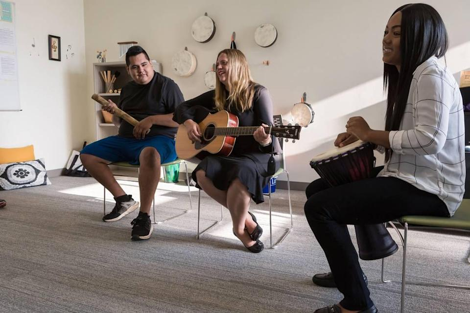HopeWay clients play songs with music therapist Joan Kleinmann, center, as part of their integrative therapy.