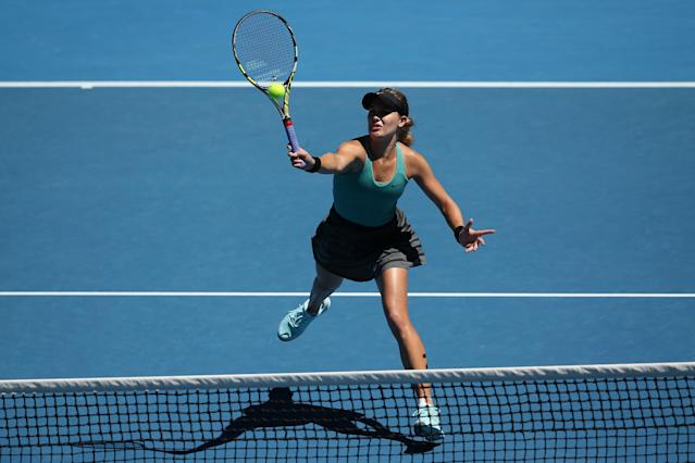 MELBOURNE, AUSTRALIA - JANUARY 21: Eugenie Bouchard of Canada plays a forehand in her quarterfinal match against Ana Ivanovic of Serbia during day nine of the 2014 Australian Open at Melbourne Park on January 21, 2014 in Melbourne, Australia. (Photo by Clive Brunskill/Getty Images)