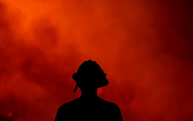 <p>A firefighter keeps watch on the Holy Fire burning in the Cleveland National Forest in Lake Elsinore, Calif., Thursday, Aug. 9, 2018. (Photo: Ringo H.W. Chiu/AP) </p>