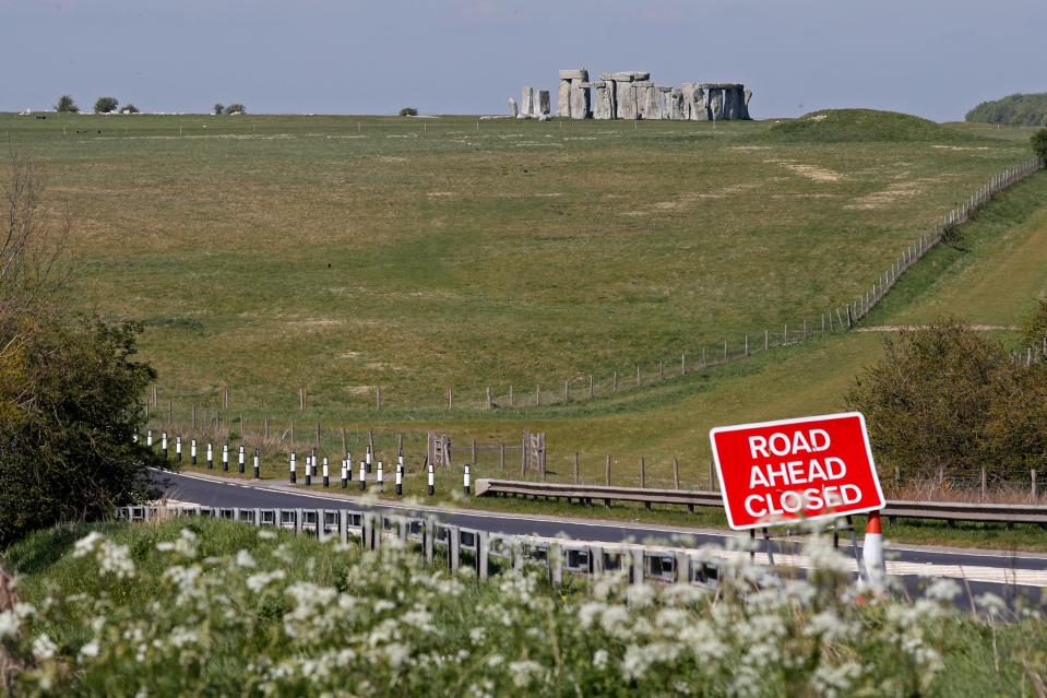 A sign warns of a road closure on the route to the prehistoric monument at Stonehenge. (Getty Images)