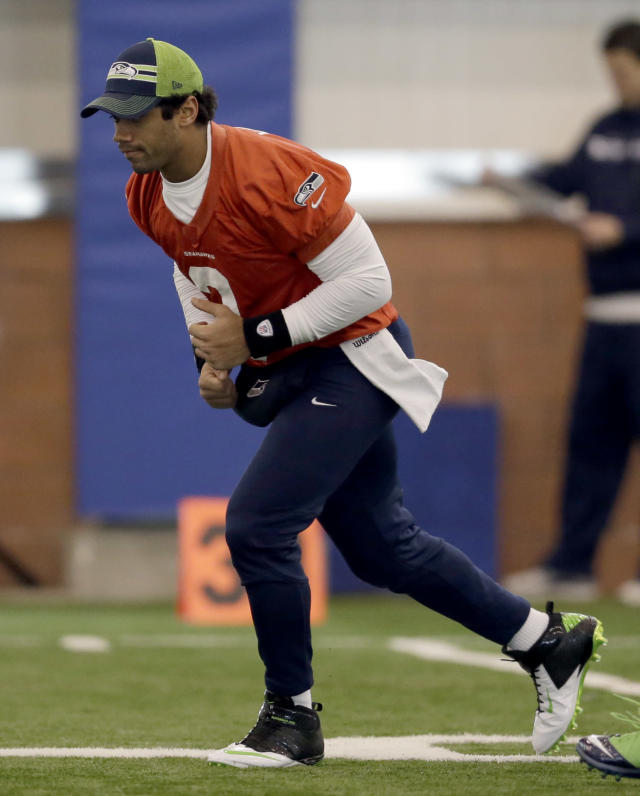 Seattle Seahawks quarterback Russell Wilson warms up during NFL football practice Friday, Jan. 31, 2014, in East Rutherford, N.J. The Seahawks and the Denver Broncos are scheduled to play in the Super Bowl XLVIII football game Sunday, Feb. 2, 2014. (AP Photo/Jeff Roberson)