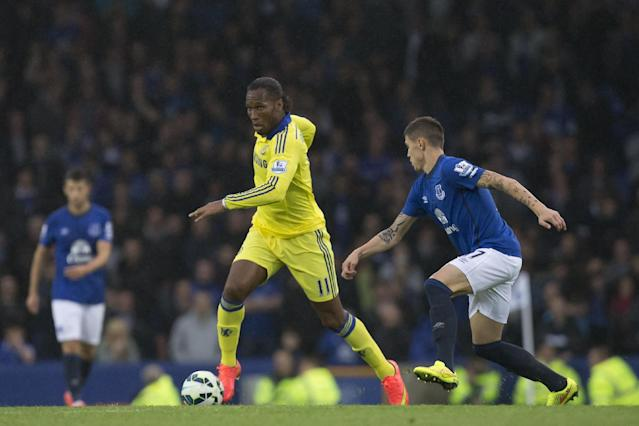 Chelsea's Didier Drogba, centre, keeps the ball from Everton's Aidan McGeady during their English Premier League soccer match at Goodison Park Stadium, Liverpool, England, Saturday Aug. 30, 2014. (AP Photo/Jon Super)