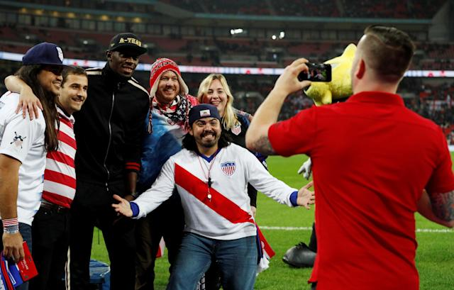 Soccer Football - International Friendly - England v United States - Wembley Stadium, London, Britain - November 15, 2018 Former sprinter Usain Bolt poses for photographs with fans of the U.S. during half time REUTERS/Darren Staples