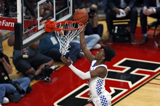 Kentucky's Ashton Hagans (0) lays the ball up during the first half of an NCAA college basketball game against Texas Tech, Saturday, Jan. 25, 2020, in Lubbock, Texas. (AP Photo/Brad Tollefson)