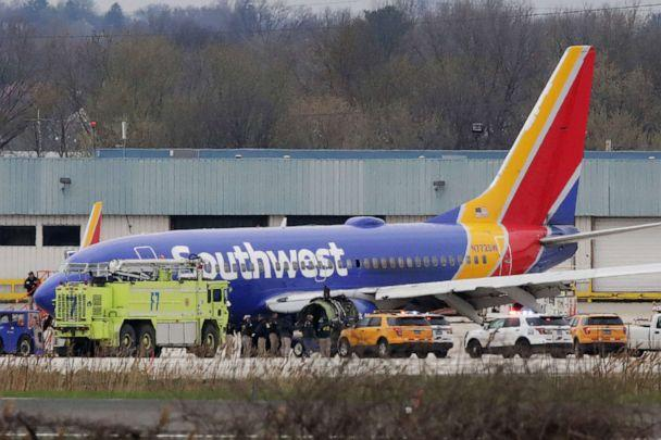 PHOTO: A Southwest Airlines jet sits on the runway at Philadelphia International Airport after it was forced to land with an engine failure, in Philadelphia, Pennsylvania, on April 17, 2018. (AFP via Getty Images, FILE)
