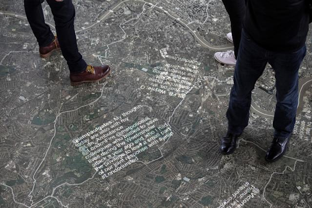 Messages are beamed onto a map at the #LondonUnited memorial at City Hall, marking the anniversaries of the four terror attacks in London in 2017 in London, Britain, March 22, 2018. REUTERS/Simon Dawson TPX IMAGES OF THE DAY