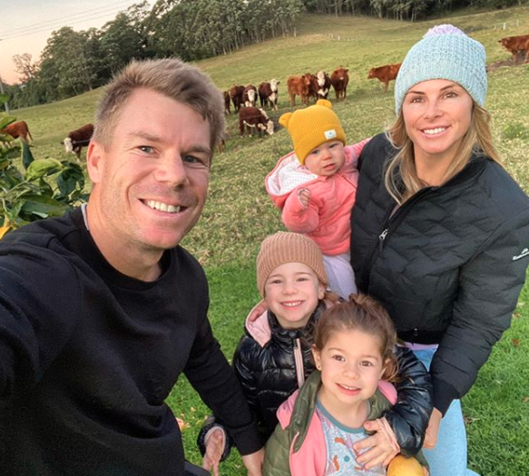 Candice and David Warner with their three children