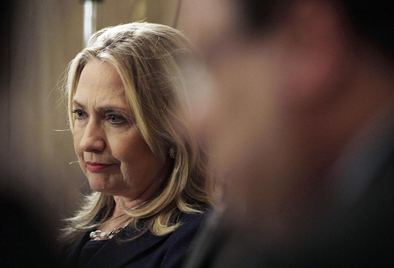 U. S. Secretary of State Hillary Rodham Clinton listens to a question during a joint press conference with Egyptian Foreign Minister Mohammed Kamel Amr, not shown, at the presidential palace in Cairo, Egypt, Saturday, July 14, 2012. (AP Photo/Maya Alleruzzo)