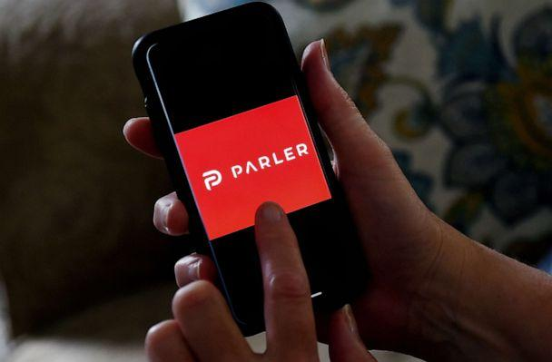 PHOTO: The social media application logo from Parler is displayed on a smartphone in Arlington, Va., July 2, 2020.  (Olivier Douliery/AFP via Getty Images)