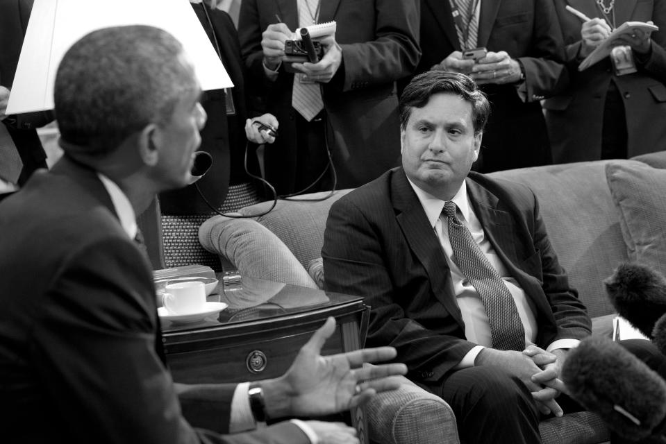 Reporters take notes as Ebola coordinator Ron Klain listens to President Barack Obama speak to the media about the government's Ebola response in the Oval Office of the White House in Washington in October 2014. (Jacquelyn Martin/AP)