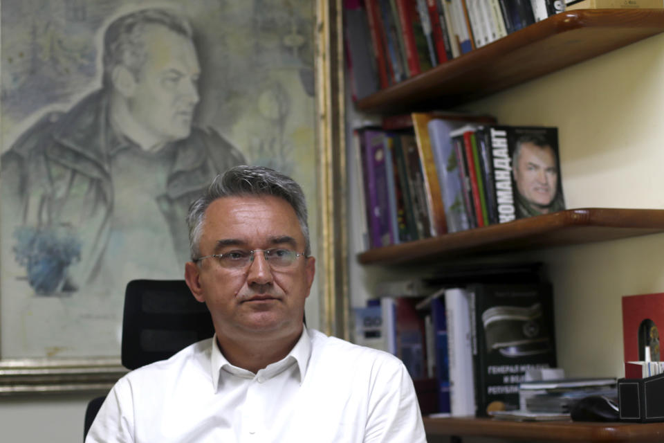 Darko Mladic, son of Gen. Ratko Mladic listens to a question during an interview with the Associated Press in Belgrade, Serbia, Wednesday, May 26, 2021. U.N. judges on Tuesday, June 8 deliver their final ruling on the conviction of former Bosnian Serb army chief Radko Mladic on charges of genocide, war crimes and crimes against humanity during Bosnia's 1992-95 ethnic carnage. Nearly three decades after the end of Europe's worst conflict since World War II that killed more than 100,000 people, a U.N. court is set to close the case of the Bosnian War's most notorious figure. (AP Photo/Darko Vojinovic)