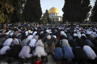 Muslims take part in Eid al-Fitr prayers at the Dome of the Rock Mosque in the Al-Aqsa Mosque compound in the Old City of Jerusalem, Thursday, May 13, 2021. Eid al-Fitr, festival of breaking of the fast, marks the end of the holy month of Ramadan. (AP Photo/Mahmoud Illean)