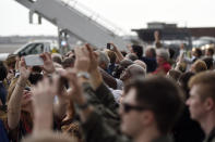 Supporters film the arrival of Vice President Mike Pence at Joint Base Charleston in North Charleston, S.C.m Thursday, Feb. 13, 2020. (AP Photo/Meg Kinnard