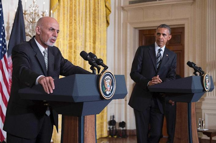 US President Barack Obama (R) listens as Afghanistan President Ashraf Ghani speaks during a joint press conference at the White House in Washington, DC on March 24, 2015 (AFP Photo/Jim Watson)