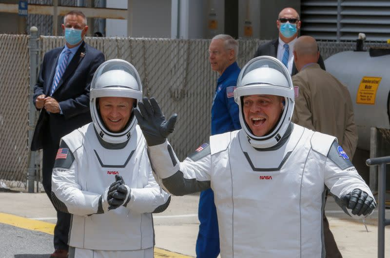 NASA astronauts Douglas Hurley and Robert Behnken head to launch pad 39 to board a SpaceX Falcon 9 rocket during NASA's SpaceX Demo-2 mission to the International Space Station from NASA's Kennedy Space Center in Cape Canaveral