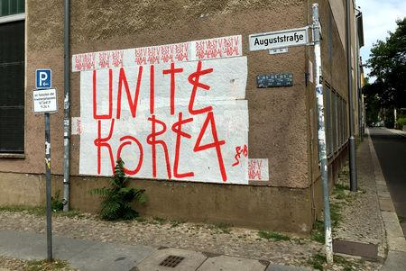 "A mural reading ""Unite Korea"" is pictured in Berlin, Germany July 8, 2018. Picture taken July 8, 2018.     REUTERS/Paul Carrel"