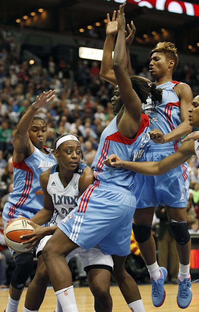 Minnesota Lynx guard Monica Wright, second from left, looks to make a pass against the defense of Atlanta Dream during Game 1 of the WNBA basketball finals, Sunday, Oct. 6, 2013, in Minneapolis. The Lynx won 84-59. (AP Photo/Stacy Bengs)