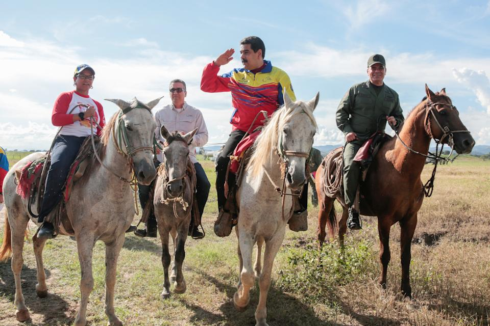 Venezuela's President Nicolas Maduro (2nd R) rides a horse next to Defense Minister Vladimir Padrino Lopez (R) during an event related to a government plan for planting and harvesting cereal crops, in San Carlos, Venezuela, September 22, 2016. Miraflores Palace/Handout via REUTERS ATTENTION EDITORS - THIS PICTURE WAS PROVIDED BY A THIRD PARTY. EDITORIAL USE ONLY.     TPX IMAGES OF THE DAY