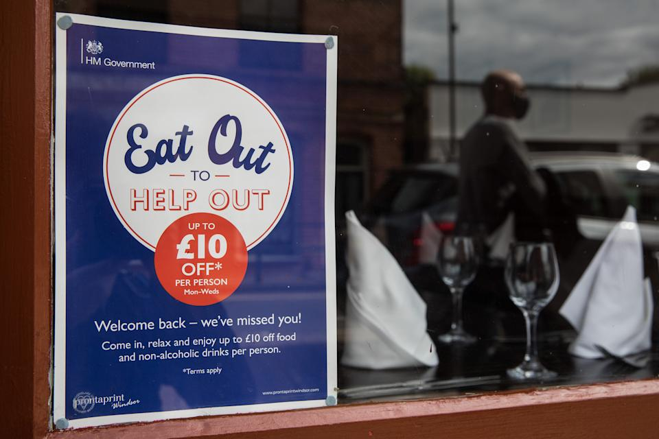 An Eat Out To Help Out poster is pictured in a restaurant window on the final day of the governments subsidised meal scheme on 31 August 2020 in Windsor, United Kingdom. Many restaurant owners have called for an extension to the scheme introduced by the Chancellor of the Exchequer to help preserve hospitality jobs during the COVID-19 pandemic. (photo by Mark Kerrison/In Pictures via Getty Images)