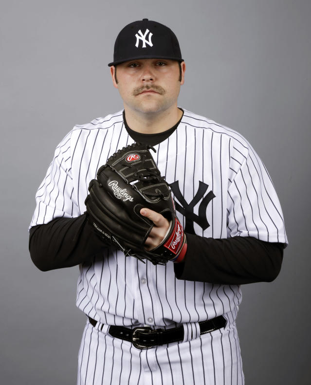 FILE - This 2013 file photo shows Joba Chamberlain of the New York Yankees baseball team. A person familiar with the negotiations says the Detroit Tigers and Chamberlain have agreed to terms on a one-year contract. The person spoke on condition of anonymity to The Associated Press on Thursday, Dec. 12, 2013, because the deal hadn't been announced. (AP Photo/Matt Slocum, File)