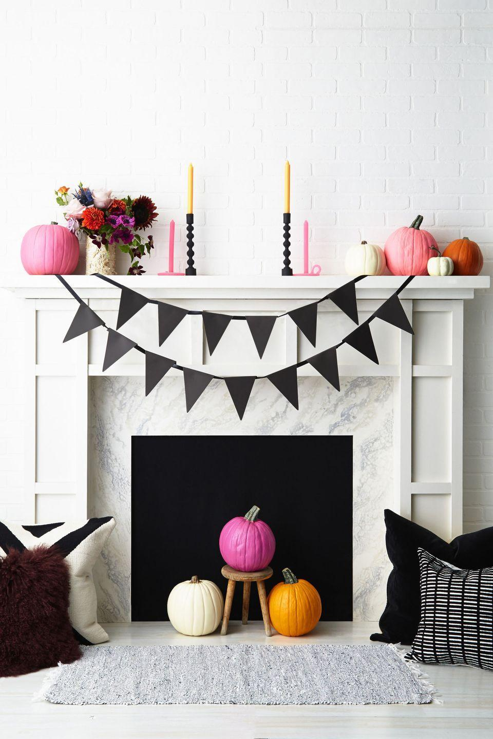 "<p>Skip the traditional orange decor in lieu of another hue (<span class=""redactor-unlink"">pink</span>, for example) and the result can be a lot more cheerful and unique. Round out the fireplace with a DIY pennant spelling out ""Happy Halloween""—or another message from beyond the grave. Get the tutorial at <a href=""http://www.goodhousekeeping.com/holidays/halloween-ideas/g421/halloween-decorating-ideas-1007/"" rel=""nofollow noopener"" target=""_blank"" data-ylk=""slk:Good Housekeeping"" class=""link rapid-noclick-resp"">Good Housekeeping</a>. </p><p><a class=""link rapid-noclick-resp"" href=""https://www.amazon.com/Apple-Barrel-Acrylic-Assorted-21049E/dp/B01FJ2HFYC/ref=sr_1_4?tag=syn-yahoo-20&ascsubtag=%5Bartid%7C10057.g.2554%5Bsrc%7Cyahoo-us"" rel=""nofollow noopener"" target=""_blank"" data-ylk=""slk:BUY NOW"">BUY NOW</a> <strong><em>Pink Acrylic Paint, $6</em></strong></p>"
