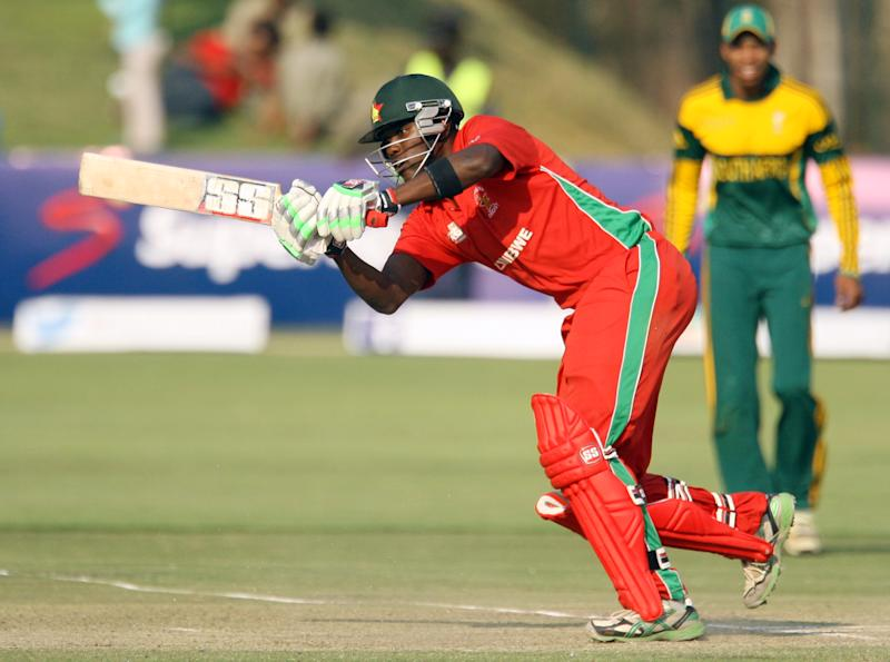 Zimbabwe captain Elton Chigumbura eyes the ball during a one-day international against South Africa in Harare on August 29, 2014