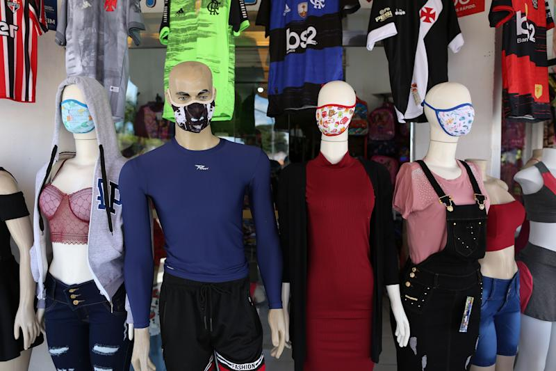 Mannequins wearing face masks are seen at a store in Parintins, Amazonas state, Brazil on June 27, 2020, amid the new coronavirus. - Parintins is well-known internationally for its Boi-Bumba folklore festival, which lasts for three days in late June and which themes, costumes and songs are based on indigenous cultures of the Amazon rainforest. A live streaming replaced the festival this year to prevent the spread of COVID-19. (Photo by MICHAEL DANTAS / AFP) (Photo by MICHAEL DANTAS/AFP via Getty Images)