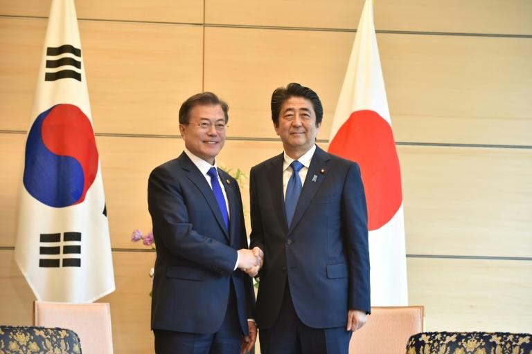 South Korea's President Moon Jae-in in happier times with Japan's Prime Minister Shinzo Abe