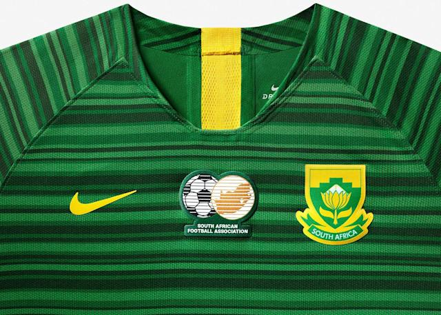 <p>The away kit is a bold green with a cascading horizontal pattern. </p>
