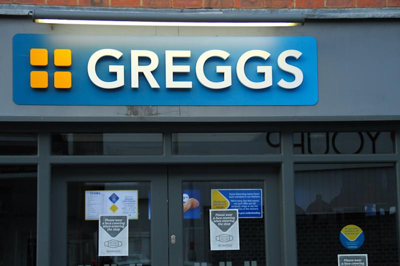 NORTHAMPTONSHIRE, UNITED KINGDOM - 2020/08/01: Posters advising customers on Covid-19 prevention measures posted on a Greggs shop on the High Street The Government has made it mandatory to wear face coverings in all public transport, supermarkets and indoor shopping centres as a measure to combat the spread of the novel coronavirus. (Photo by David Mbiyu/SOPA Images/LightRocket via Getty Images)