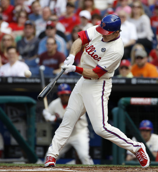 Philadelphia Phillies' Chase Utley hits a two-run home run off Los Angeles Dodgers starting pitcher Dan Haren during the first inning of a baseball game, Saturday, May 24, 2014, in Philadelphia. (AP Photo/Matt Slocum)