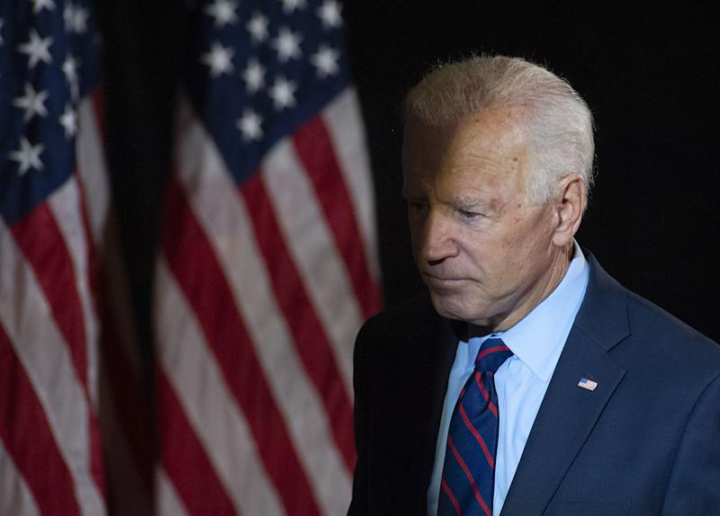 Former Vice President Joe Biden exits the stage after making remarks about revelations that President Donald Trump asked Ukraine to investigate him,