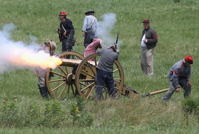 GETTYSBURG, PA - JUNE 30: Confederate Civil War re-enactors fire a cannon towards Union positions during Pickett's Charge on the last day of a Battle of Gettysburg re-enactment on June 30, 2013 in Gettysburg, Pennsylvania. Some 8,000 re-enactors from the Blue Gray Alliance participated in the event, marking the 150th anniversary of the July 1-3, 1863 Battle of Gettysburg. Confederate General Robert E. Lee's Army of Northern Virginia was routed during the doomed frontal assault, considered the turning point in the Civil War and a watershed moment in U.S. history. Union and Confederate armies suffered a combined total of up to 51,000 casualties over three days, the highest number of any battle in the four-year war. Pickett's charge was named for the Confederate Maj. General George Pickett, whose division of rebel troops was annhilated in the attack. (Photo by John Moore/Getty Images)