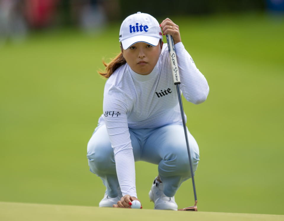 Jin Young Ko, of South Korea, lines up her putt on the first hole during the third round of the CP Women's Open in Aurora, Ontario, Canada, Saturday, Aug. 24, 2019. (Frank Gunn/The Canadian Press via AP)