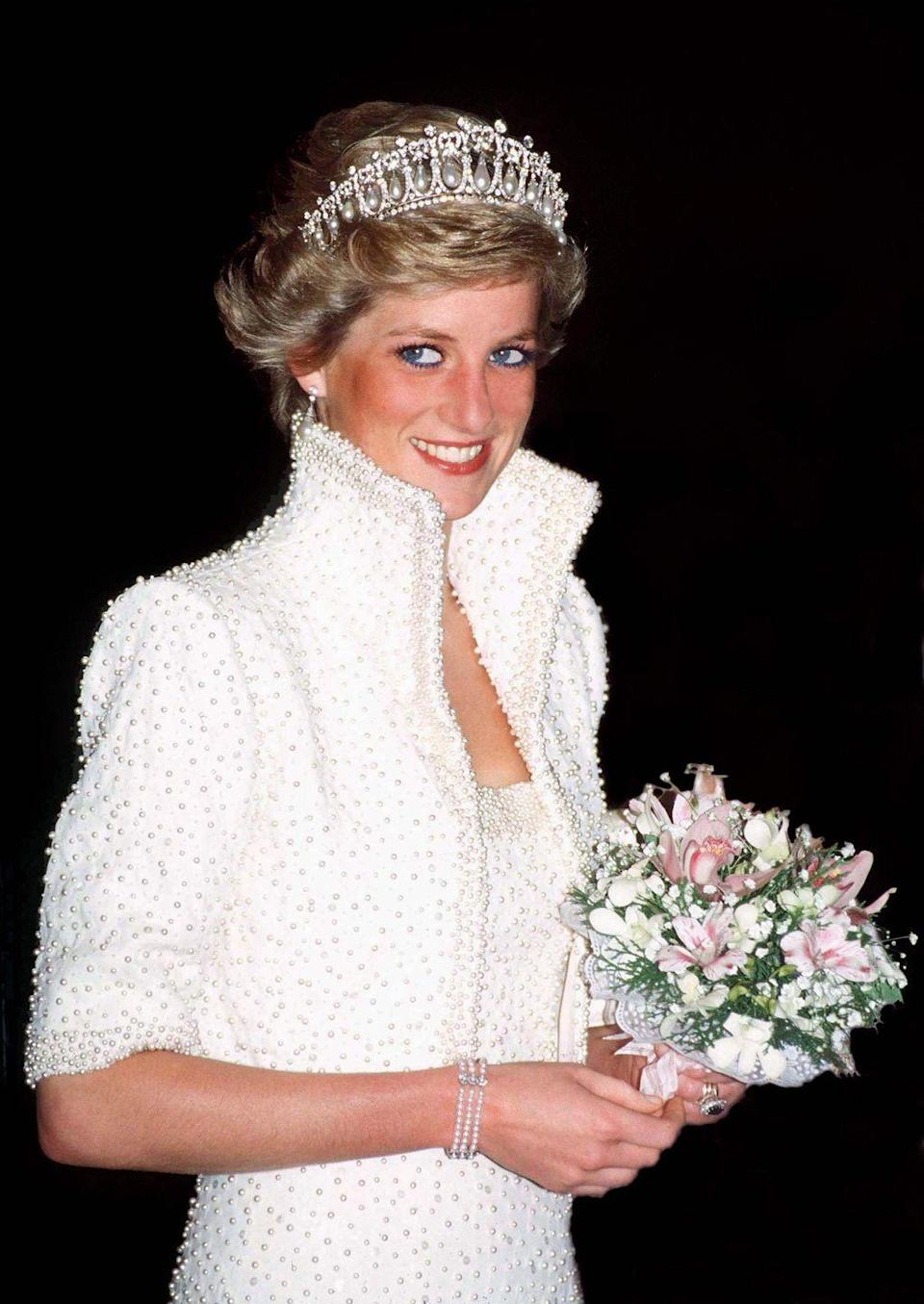 <p>For this outfit, Princess Diana went all in on the pearls. The white, pearl-embellished dress and jacket combination was created by Catherine Walker, one of Diana's favorite fashion designers. To complete this look, which Diana wore on a visit to Hong Kong, the Princess wore the Lover's Knot tiara and a three-strand pearl bracelet. </p>