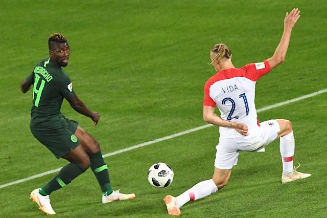 Croatia's defender Domagoj Vida (R) fights for the ball with Nigeria's forward Kelechi Iheanacho during the Russia 2018 World Cup Group D football match at the Kaliningrad Stadium in Kaliningrad on June 16, 2018 (AFP Photo/Attila KISBENEDEK)