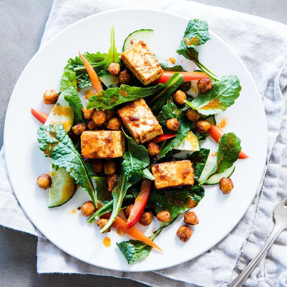 <p>To top this zesty raw kale salad recipe, we toss diced tofu and chickpeas with a flavorful Moroccan-inspired spice mixture before roasting. The hot oven turns the outside of the tofu crisp and the inside pleasantly chewy.</p>