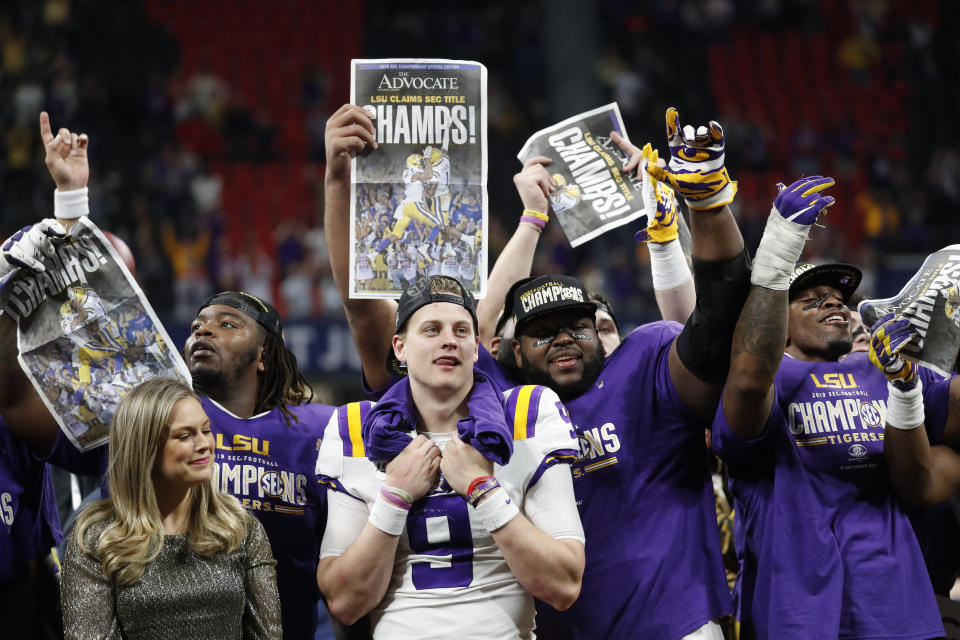 LSU quarterback Joe Burrow (9) is one of many SEC players expected to go in the first round of the NFL draft. (AP Photo/John Bazemore)