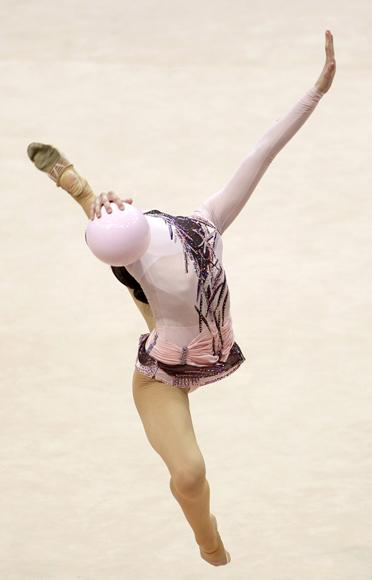 Ukraine's Alina Maksymenko performs during the individual ball competition at the 27th Rhythmic Gymnastics European Championship in Minsk, May 27, 2011. (REUTERS/Vasily Fedosenko)