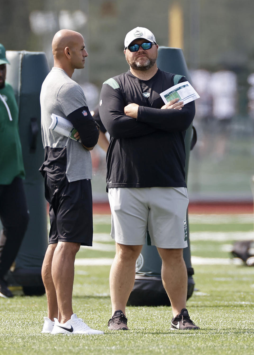 New York Jets general manager Joe Douglas, right, talks with head coach Robert Saleh during NFL football practice Wednesday, July 28, 2021, in Florham Park, N.J. (AP Photo/Adam Hunger)